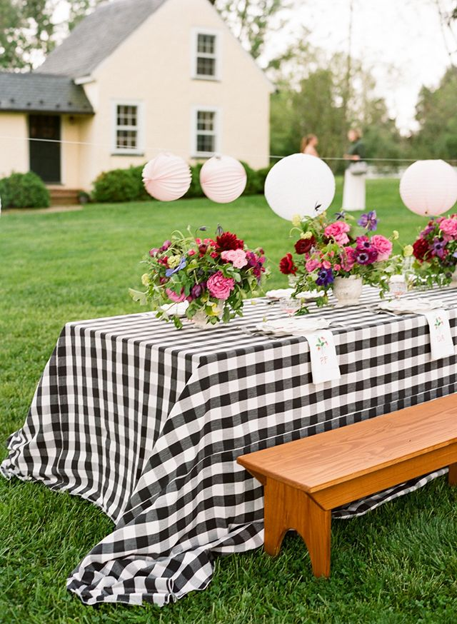 Picnic Style BBQ in Charlottesville with Gingham Linens, Picnic Tables, Lanterns, pink and purple florals.  Photo: Karen Hill