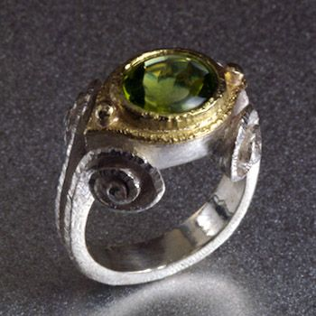 Nadine Kariya: , Peridot spiral ring in sterling silver, 18k gold, and 3 carat peridot. Stone measures 10 x 8mm. Band is 4mm wide. Size 7.5 (may be sized to fit)