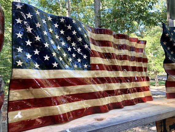 Hand Carved Waving Wood American Flag This Beautiful Large Flag Is Pieced Together In A Butche American Flag Wood Wooden American Flag Carved Wood Wall Hanging