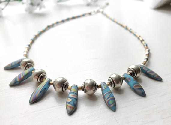 Boho necklace tribal necklace blue gold and silver dagger