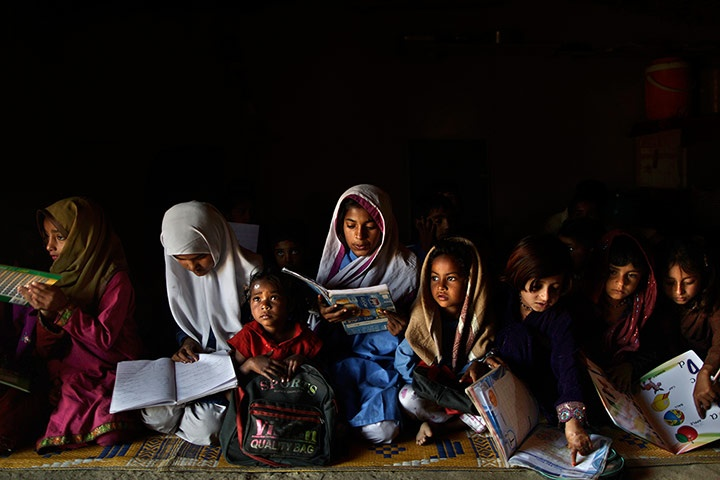 Pakistani schoolchildren attend their daily classes in a makeshift school on the outskirts of Islamabad