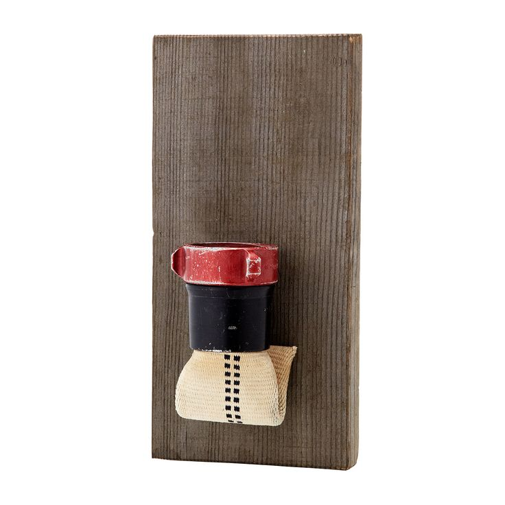 FIRE HOSE WALL POCKET | The fire hose's water-tight abilities are put to good use once again with this rough-and-tumble wall pocket/planter. | UncommonGoods