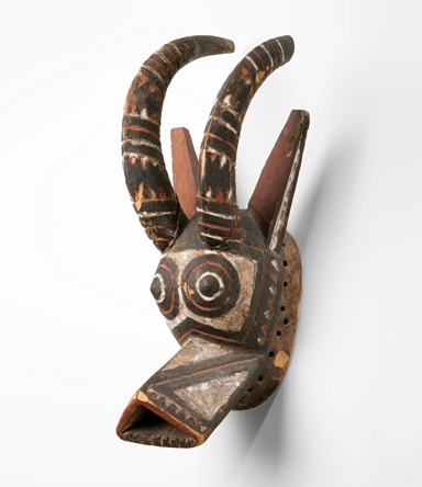Africa | Mask from Burkina Faso | Wood and pigment | 20th century