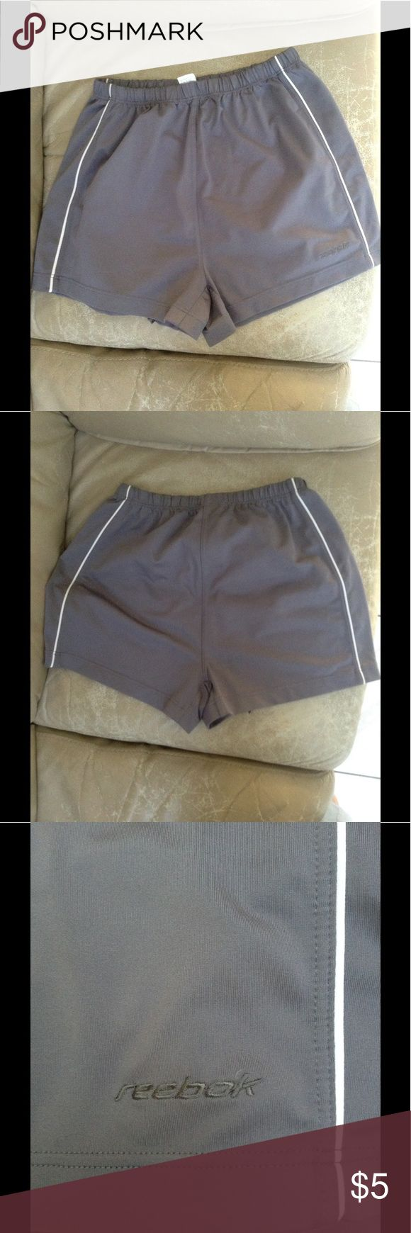Reebok women's running shorts Reebok Hydromove women's running shorts in gray with white piping, no pockets, size M. Lightly worn,no rips, holes or tears. Reebok Shorts