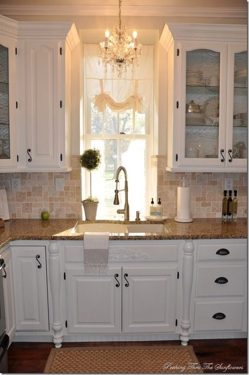 Beautiful chandy over the sink and kitchen from the blog Peeking thru the Sunflowers.