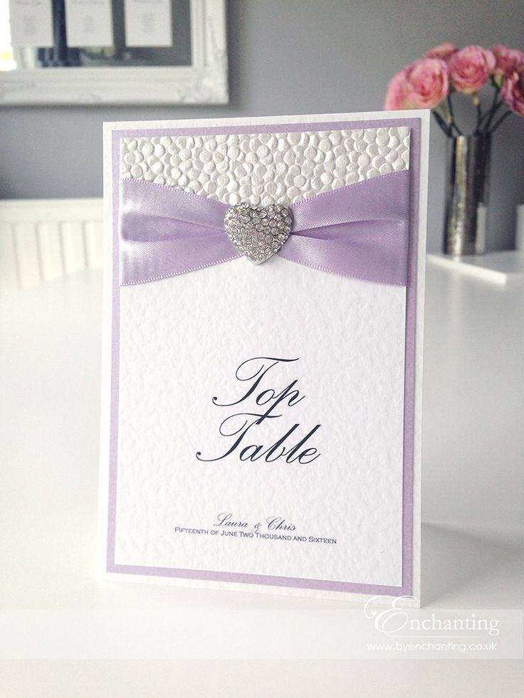 Lilac Wedding Stationery | The Ariel Collection - Table Name / Number Card | Featuring white pebble paper, purple lilac ribbon and diamaté heart embellishment | Luxury handmade wedding invitations and stationery #byenchanting