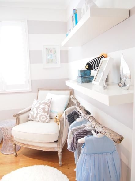 A white-washed chair makes a comfortable place to snuggle. Kelle used a budget-friendly replica of a Marcel Wanders stool as a side table, perfect for an extra baby bottle or a mug of tea. Photo courtesy of Kelle Howard-Dean
