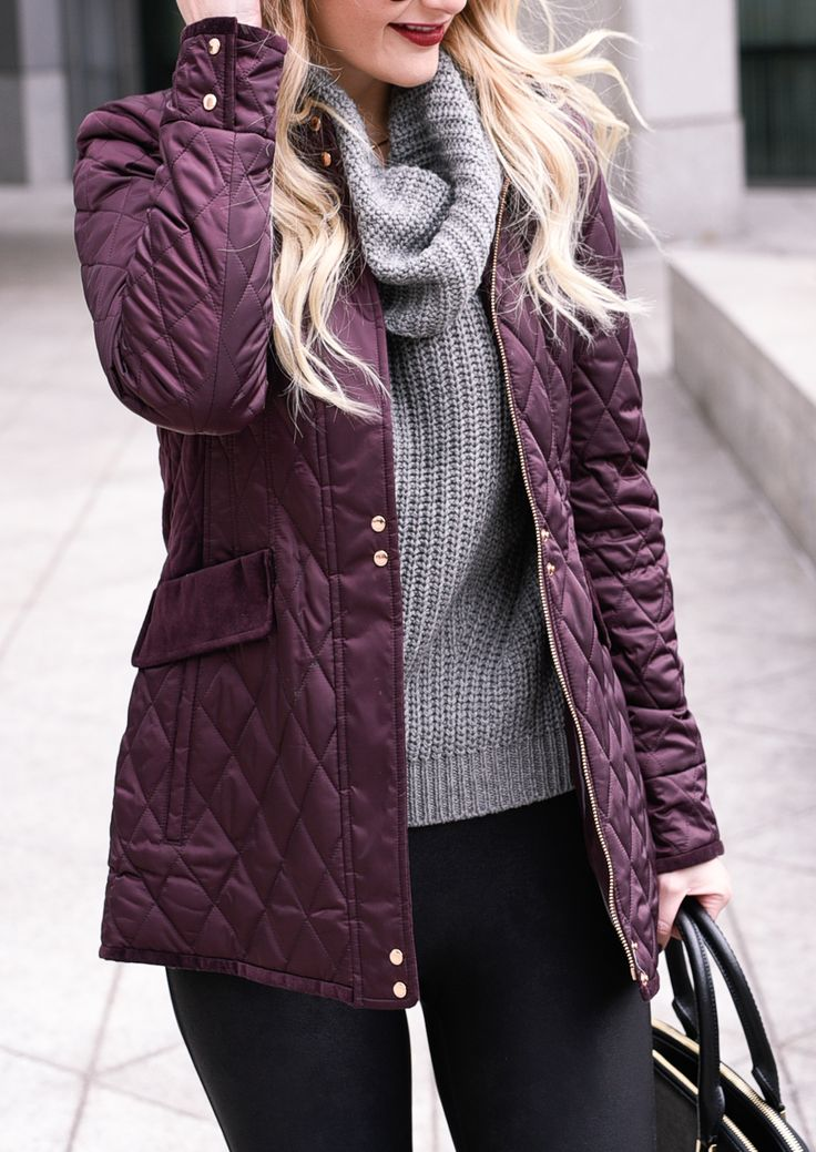 Purple quilted jacket with a grey turtleneck