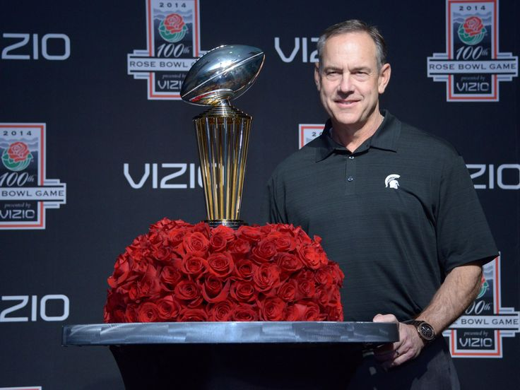 Michigan State coach Mark Dantonio poses with the Leishman Trophy
