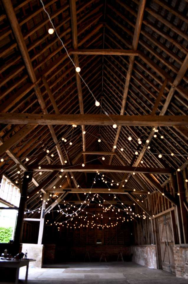 Random loops of festoon lights at North Hidden Farm. Barn wedding lighting by Oakwood Events