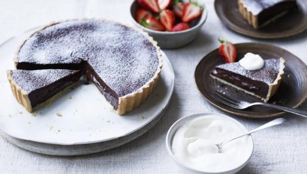 This tart looks like something you might have bought from a French patisserie, but it is so easy to make. Serve it gently warmed with a dusting of icing sugar, or top it with chocolate curls, drizzle with melted chocolate or top it with a little whipped cream and fresh summer berries. Or all three.  Equipment and preparation: you will need a 23cm/9in fluted flan tin, 3cm/1¼in deep and baking beans.