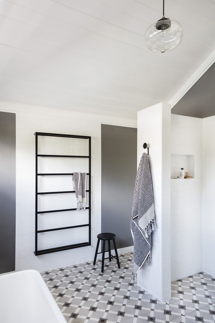 Matte black bathroom accessories make a modern statement in this functional and family friendly bathroom styled by interior designer Jo Carmichael, of Texture Tone Design. Photography: Bo Wong | Stylist: Jo Carmichael | Story: Australian House & Garden