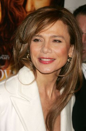 Lena Olin's bright lip and white shirt