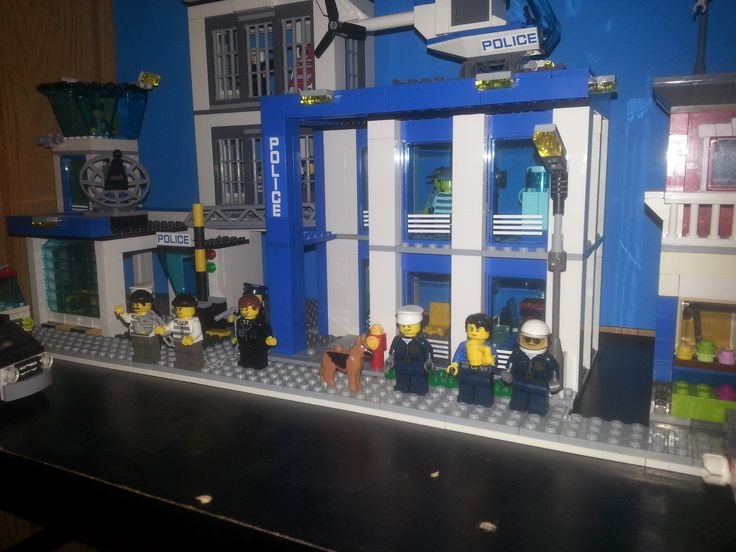 Lego City Police Station (2014 model)  at the start of my Lego Street Diorama.  I've left some space around it as this will be considerably modified once I have enough of the right pieces on hand.