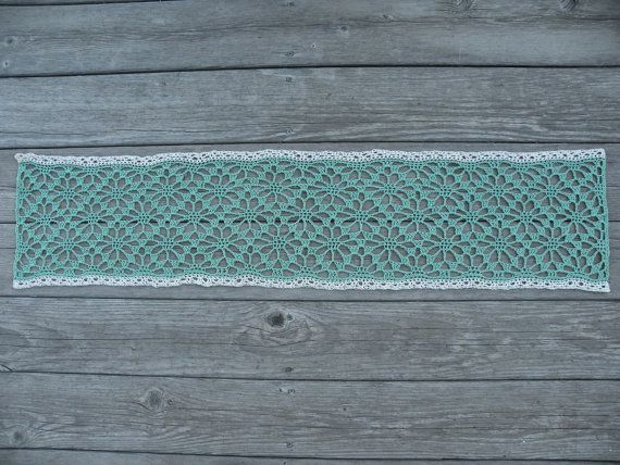This handmade table runner is the perfect addition to your home decor! Crocheted using a floral design with fine cotton yarn, this table