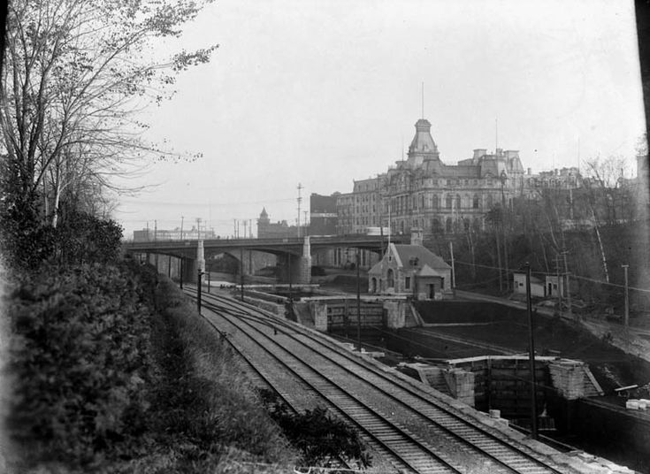 Ottawa Rideau Canal Railway Tracks June 1903.  Sappers' Bridge.  Tracks lead from Canada Atlantic Railway Station (the site will become the GTR Union Station in 1912) to Alexandra Bridge to Hull.  Old Post Office in background (it looks bigger because there is a building to the left of it.