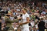 Petra Kvitova is interviewed on court by Sue Barker after winning the Ladies' Singles Final