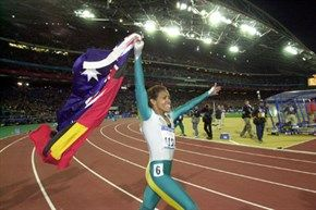 Cathy Freeman victory lap with Australian and Aboriginal Flags.