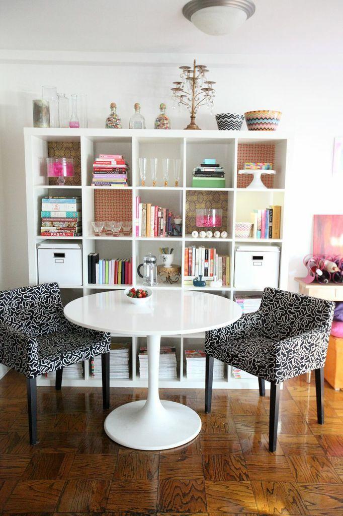 Nikki Rappaport's D.C. studio appt. // #dining #grey #print #white #table #shelves