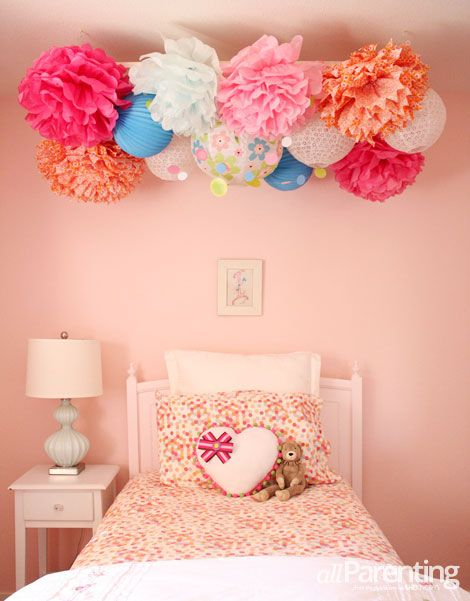 DIY pom pom chandelier. Perfect for decorating a room or a party!