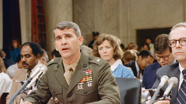 Lt. Col. Oliver North testifies before a joint committee of Congress about his role in the Iran-Contra affair and the shredding of key documents pertinent to the case (July 1987).
