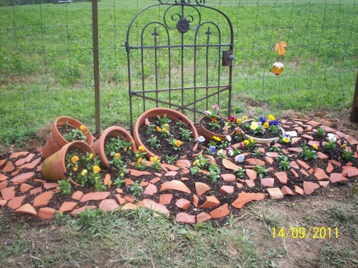 broken pot garden great use for those pots instead of a trashcan or dumpster