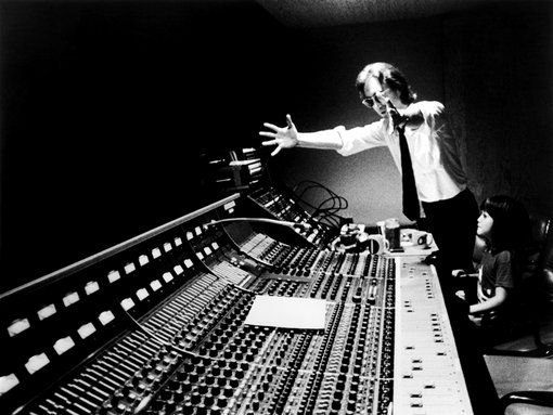 """John Lennon (with son Sean) shows off the new automated mixing board at New York's Hit-Factory, 1980. ""It looks like he's turning Sean on to the world of music,"" says photographer Bob Gruen"""