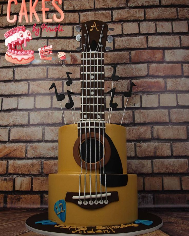A super cool acoustic guitar cake I made for this weekend! Happy Birthday Aidan…