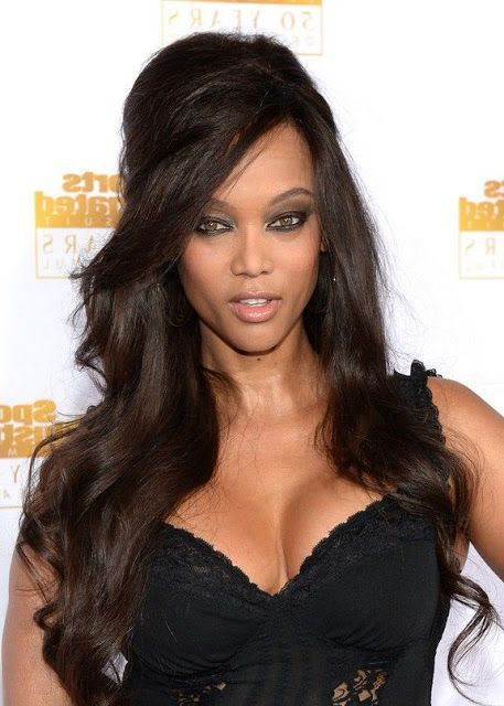 tyra banks half up half down hairstyle  http://www.hairstylo.com/2015/07/half-up-half-down-hairstyles.html