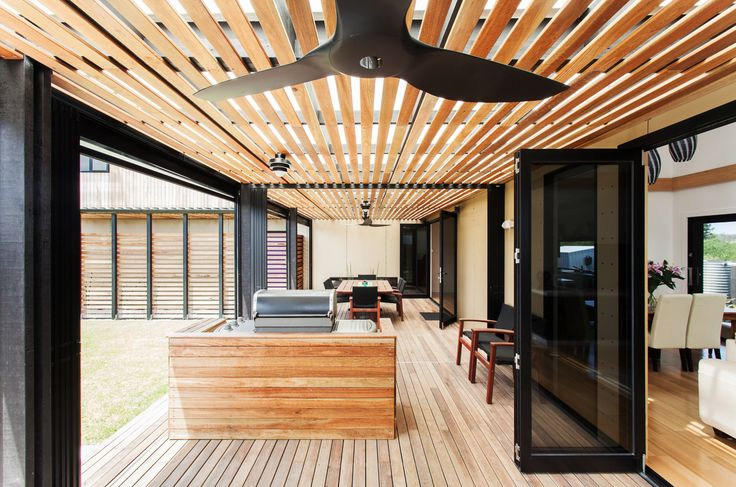 """For this four-module prefab house off the Australian coastline, local firm Archiblox's aim was """"to create an inspiring double height living area with full glazing along the northern façade that could be enjoyed throughout the changing seasons,"""" according to architect Bill McCorkell. Click through the slideshow for a tour of the light-filled home."""