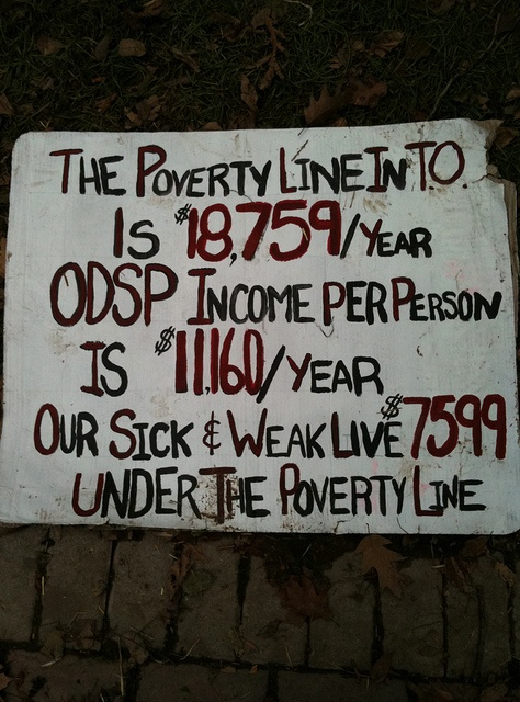 """The Poverty Line in Toronto: """"The poverty line in T.O. is $18,759/year. ODSP income per person is $11,160/year. Our sick and weak live $7599 under the poverty line."""" 