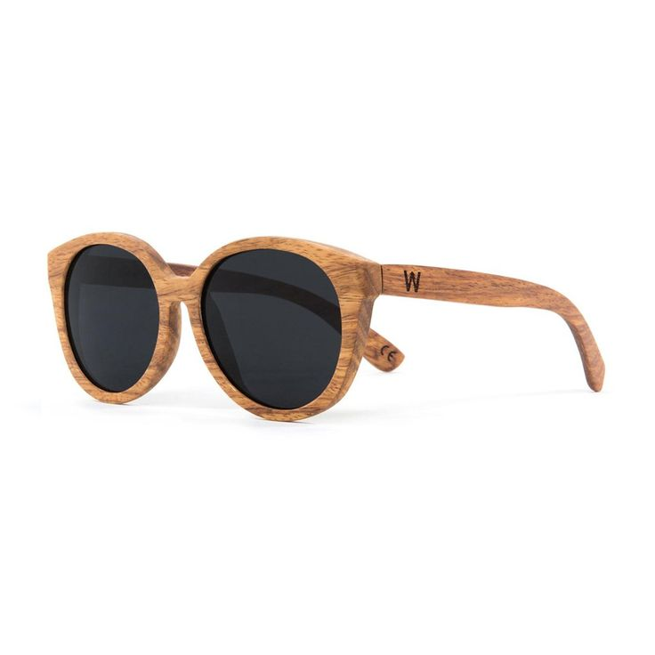 Karlie Pear Wood Sunglasses. With vintage style that's equal parts Audrey Hepburn and Twiggy, the Karlie features a sloping browline and a round oversized shape sure to catch admiring glances wherever you wander. These sunglasses are crafted from pear wood with a wax coating, featuring CR-39 polarized black lenses and stainless steel spring loaded hinges.