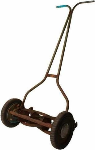 old push mower--- We had one of these and when we got on trouble my daddy would threaten to make us now the 10 acres with it.