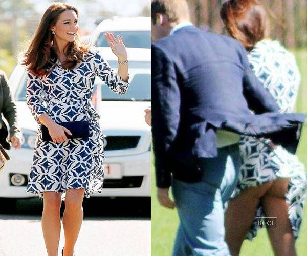 Kate Middleton suffers wardrobe malfunction as her dress was pictured blowing up around her thighs while she was getting out of a helicopter in Canada.