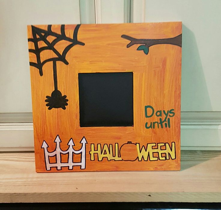 Halloween countdown chalkboard in the center. On the opposite side is countdown to Christmas.