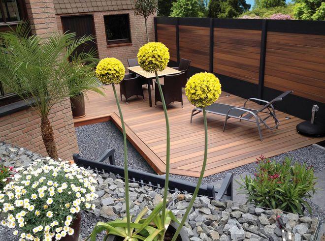 Jardin : une clôture modulable associant bois com…