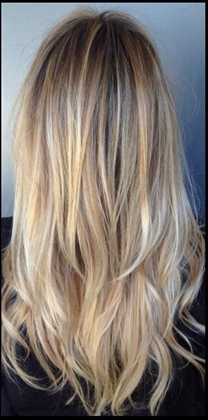 Another great shade done by colorist Katherine Hyde. Superfine blonde highlights, intricately placed throughout this client's naturally darker base create a multidimensional blonde color that we absolutely adore. Stylist Melissa Stone finishes the look with a long layered cut and style....