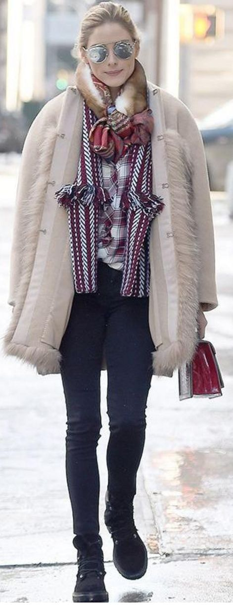 Who made Olivia Palermo's silver sunglasses, white plaid shirt, red fringe cape, tan coat, red handbag, and black ankle boots?