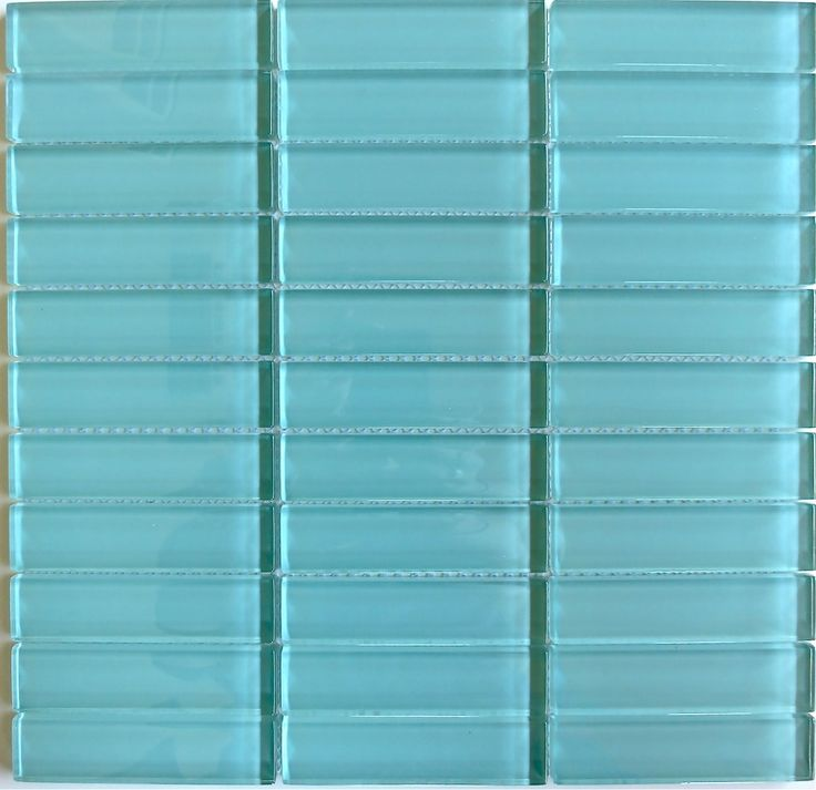 "Lush 1x4 Pool -Aqua Blue Green Glass Subway Tile - Lush 1x4 subway tile ""Pool"" is a popular Aqua blue/Green shade. This glass subway tile is ideal for any wall application including kitchen backsplash tile, bathroom tile, fireplace tile and pool tile. The skinny subway tile is laid in a modern stacked or straight joint and comes mesh mounted by the square foot sheet. It can be laid either vertically or horizontally. This tile is easy to install in wet areas as well as dry, and it is…"