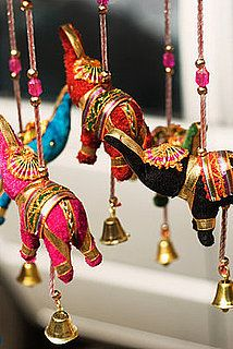 Hanging elephant figurines in beautiful bright silks to decorate the wedding reception