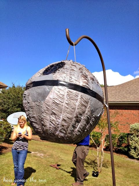 This is simply a soccer ball piñata that we painted gray and decorated like the Death Star.