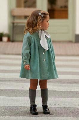 Cute vintage fashion for little girls, blue coat, white scarf and cute long socs. el RHEY approved!