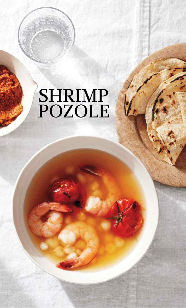 Shrimp Pozole | Martha Stewart Living - Instead of pork, this lighter take on Mexican pozole enlists shrimp, which is a tender accompaniment to those soft, puffy corn kernels (or hominy) and blistered tomatoes. Our cacao-free version of mole enriches the basic broth with its own complex flavors, including the nutty-spicy blend of almonds and an ancho chile.