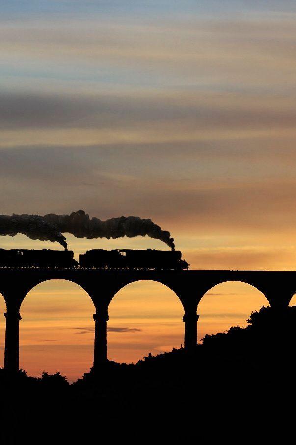 Orange + Black + Sunset + Smoke from train + Bridge