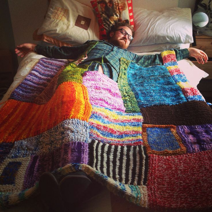 Patchwork blanket all hand spun covering the most part of my boyfriend