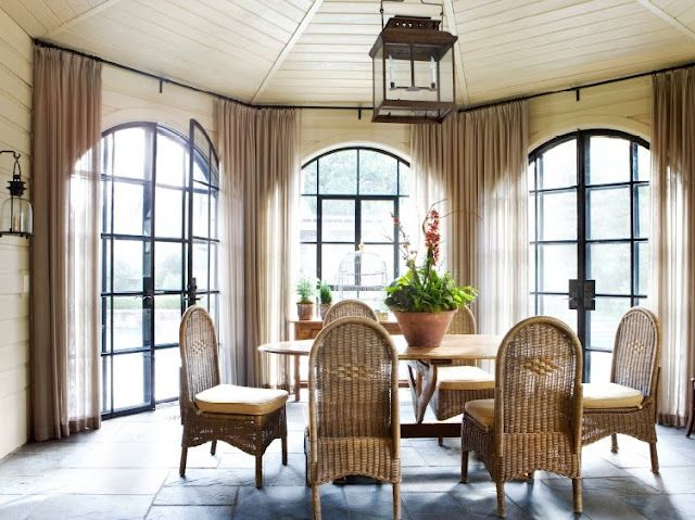 Love the way these unlined, semi-sheer linen panels play with light and dress the windows simply, without obscuring the lines of the gorgeous arched French doors