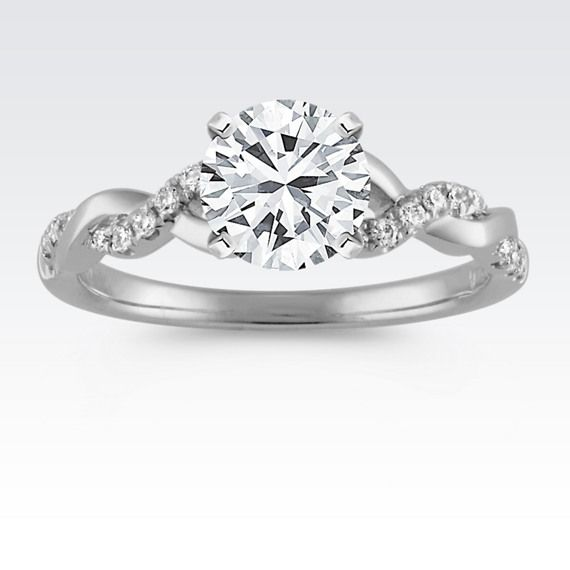 A charming, feminine infinity design in 14 karat white gold gives this engagement ring a unique look.  Featuring 18 round diamonds at approximately .12 carat total weight, simply add a center diamond to complete the look.