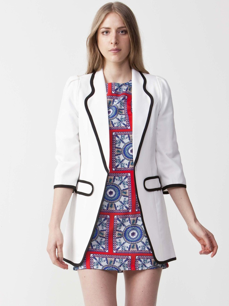 Vanessa - White Jacket with collared neckline.  Features dual front pockets with mid length sleeves.  Black trim and regular fit cut. $121.00