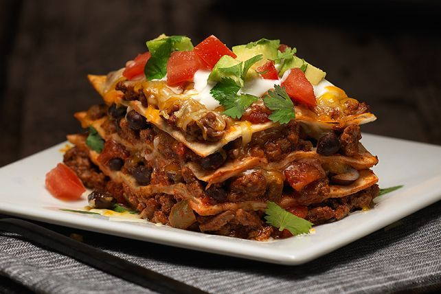 1 lb. lean ground beef 3/4 cup TACO BELL® Thick & Chunky Medium Salsa 1 pkg. (1 oz.) TACO BELL® Taco Seasoning Mix 6 flour tortillas (6 inch) 1 can (15.5 oz.) black beans, rinsed 1-1/2 cups KRAFT Mexican Style Finely Shredded Taco Cheese 1 tomato, seeded, chopped 1/4 cup chopped fresh cilantro 1/2 cup chopped avocados 1/4 cup BREAKSTONE'S or KNUDSEN Sour Cream