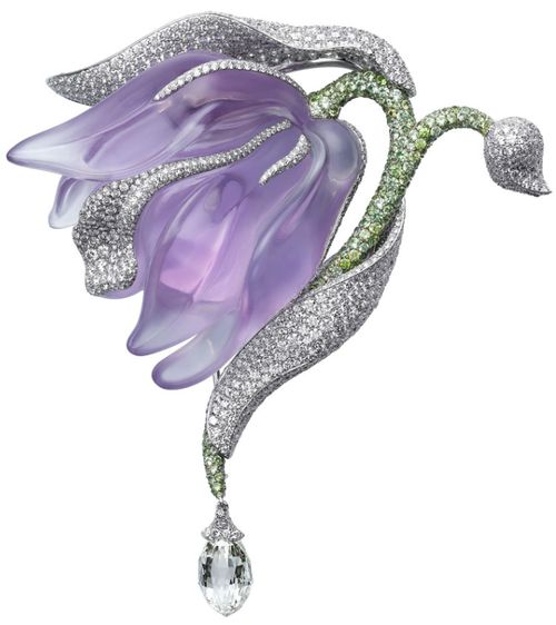 Caresse d'Orchidées par Cartier brooch. Platinum, amethyst, garnets, briolette-cut diamonds, diamonds. PHOTO: Vincent Wulveryck © Cartier 2011    Via The Jewellery Editor.